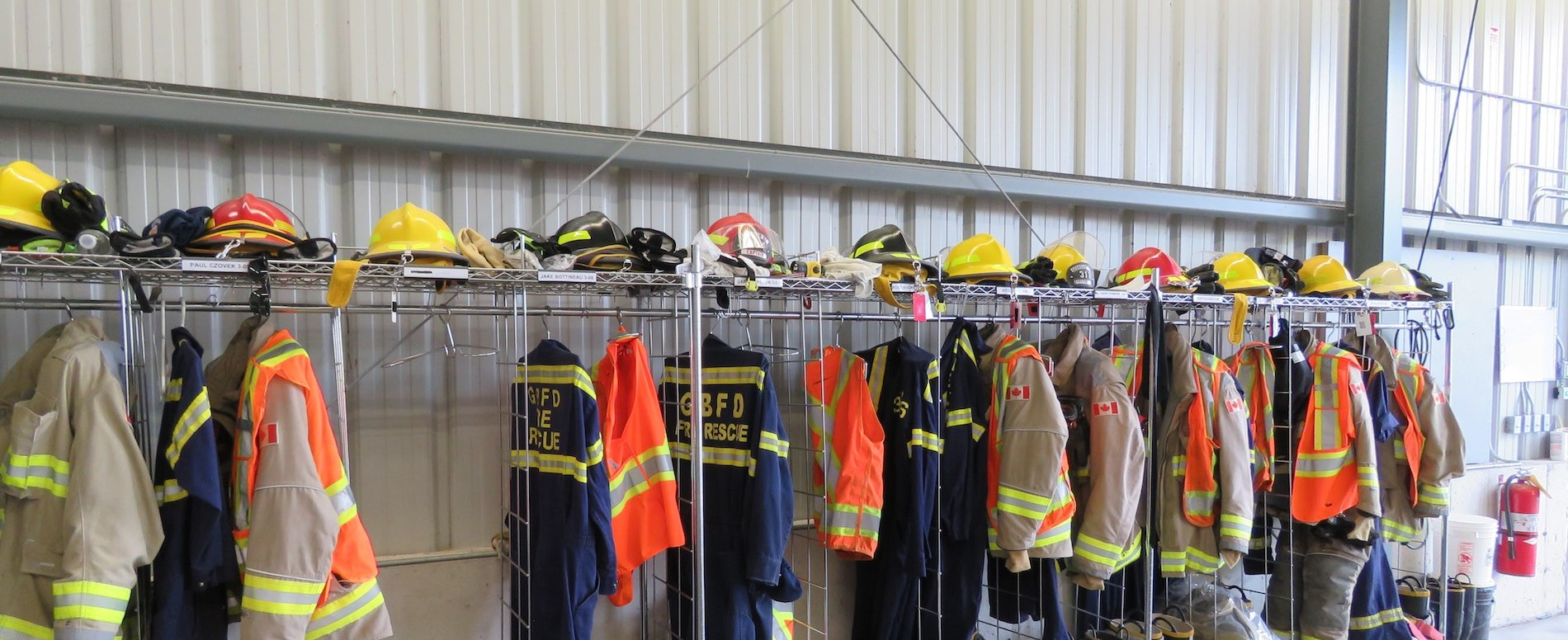 Firefighter equipment hanging on hooks